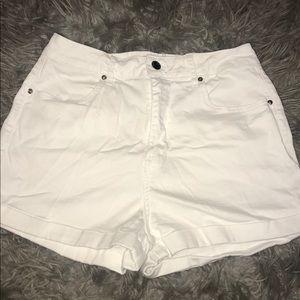 High waisted white denim shorts.